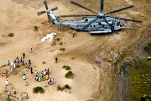 U.S. Marines from the 26th Marine Expeditionary Unit unload food and supplies to Pakistanis in support of the flood relief effort in Pano Aqil, Pakistan, Sept. 11, 2010. (U.S. Army photo by Sgt. Jason Bushong/Released)